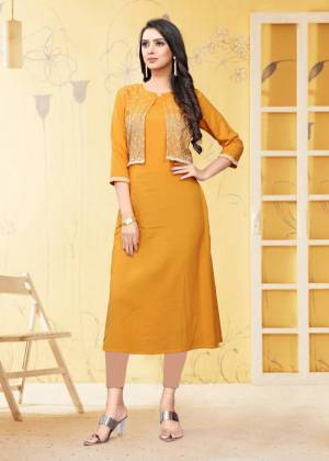 For Your Semi-Casual Wear, Grab This Readymade Kurti In Yellow Color Fabricated On Rayon Flex. It Is Beautified With DetailedThread Work. You Can Pair This Up With Same Or Contrasting Colored Bottom. Buy Now.