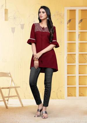 For Your Semi-Casual Wear, Grab This Readymade Kurti In Maroon Color Fabricated On Rayon Flex. It Is Beautified With DetailedThread Work. You Can Pair This Up With Same Or Contrasting Colored Bottom. Buy Now.