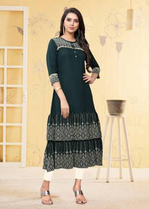 For Your Semi-Casual Wear, Grab This Readymade Kurti In Teal Blue Color Fabricated On Rayon Flex. It Is Beautified With DetailedThread Work. You Can Pair This Up With Same Or Contrasting Colored Bottom. Buy Now.