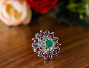 Here Is A Pretty Traditional Looking Ring In Silver Color In Oxidize Material. This Pretty Ring Is Beautified With Multi Color Stone Work And You Can Pair This Up With Any Colored Traditional Attire. Buy Now.