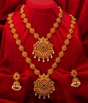 To Give A Heavy Tradiotional Look, Grab This Beautiful Set Of Necklace Which Contains Two Necklaces And A Pair Of Earring. This Necklace Set Can Be Paired With Any Colored Traditional Attire And Also Can Be Wore Both At A Time Or Single As Per The Occasion
