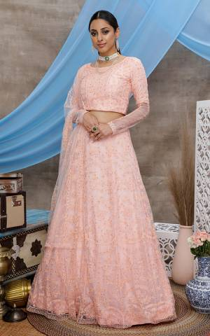 You Will Definitely Earn Lots Of Compliments Wearing This Heavy Designer Lehenga Choli In All Over Peach Color. Its Pretty Blouse, Lehenga and Dupatta Are Fabricated On Net Beautified with Tone To Tone Thread Embroidery And Stone Work. Buy This Elegant Peice Now.