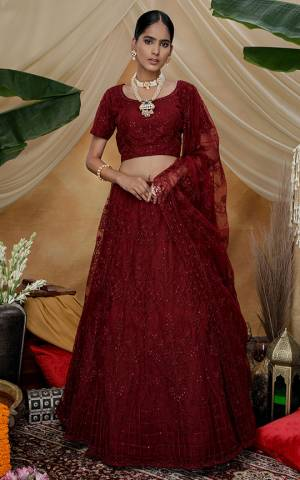 You Will Definitely Earn Lots Of Compliments Wearing This Heavy Designer Lehenga Choli In All Over Maroon Color. Its Pretty Blouse, Lehenga and Dupatta Are Fabricated On Net Beautified with Tone To Tone Thread Embroidery And Stone Work. Buy This Elegant Peice Now.