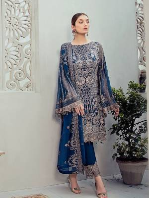 Grab This Attractive Looking Heavy Designer Straight Suit In Blue Color. Its Embroidered Top And Dupatta Are Georgette Based Paired With Santoon Bottom. Buy This Pretty Suit Now.