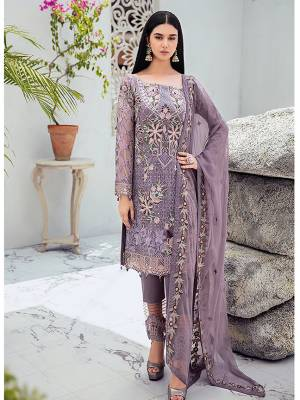Grab This Attractive Looking Heavy Designer Straight Suit In Mauve Color. Its Embroidered Top And Dupatta Are Georgette Based Paired With Santoon Bottom. Buy This Pretty Suit Now.