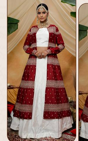 Adorn A Lovely Indo-Western Look Wearing This Designer Lehenga Choli In White Color Paired With Red Colored Heavy Embroidered Jacket. This Lehenga Choli and Jacket Are Fabricated On Chinon Which Is Light Weight And Easy To Carry Throughout The Gala.