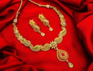 Give An Enhanced Look To Your Personality By Pairing Up This Beautiful Necklace Set With Your Ethnic Attire. This Pretty Set Is In Golden Color Beautified With Stone Work. Buy Now.