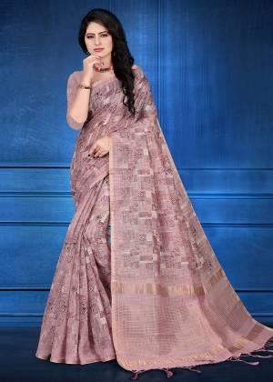 Here Is A Pretty Printed Saree For Your Semi-Casuals Or Festive Wear In Mauve Color. This Saree And Blouse Are Fabricated On Cotton Silk Beautified With Prints And Jari Checks.