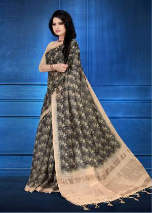 Here Is A Pretty Printed Saree For Your Semi-Casuals Or Festive Wear In Dark Grey Color. This Saree And Blouse Are Fabricated On Cotton Silk Beautified With Prints And Jari Checks.