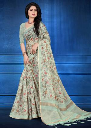 You Will Definitely Earn Lots Of Compliments Wearing This Designer Saree In Pastel Green Color. This Saree And Blouse Are Cotton Silk Based Beautified With Jari Checks And Prints. It Is Light In Weight And Easy To Carry All Day Long.