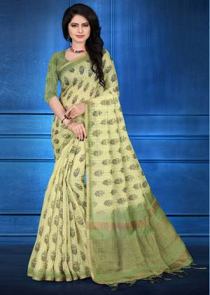 Here Is A Pretty Printed Saree For Your Semi-Casuals Or Festive Wear In Light Green Color. This Saree And Blouse Are Fabricated On Cotton Silk Beautified With Prints And Jari Checks.