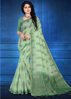 You Will Definitely Earn Lots Of Compliments Wearing This Designer Saree In Light Green Color. This Saree And Blouse Are Cotton Silk Based Beautified With Jari Checks And Prints. It Is Light In Weight And Easy To Carry All Day Long.