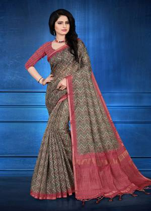 You Will Definitely Earn Lots Of Compliments Wearing This Designer Saree In Dark Grey Color. This Saree And Blouse Are Cotton Silk Based Beautified With Jari Checks And Prints. It Is Light In Weight And Easy To Carry All Day Long.