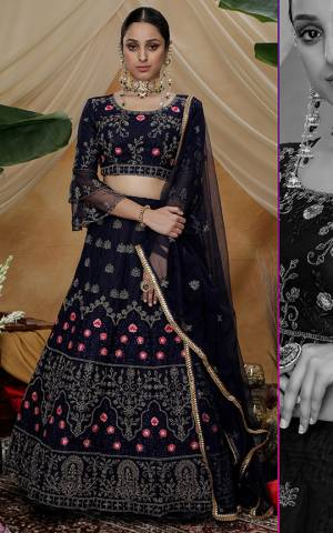 You Will Definitely Earn Lots Of Compliments Wearing This Heavy Designer Lehenga Choli In Navy Blue Color. Its Blouse, Lehenga And Dupatta Are Fabricated On Net Beautified With Attractive Embroidery Work.