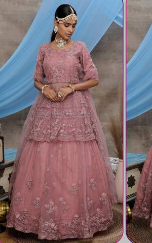Look Pretty In This Beautiful Heavy Designer Lehenga Choli Is Dusty Pink Color. This Attractive Embroidered Lehenga Choli Is Fabricated On Net Paired With Net Fabricated Dupatta. It Is Light In Weight And Easy To Carry All Day Long.