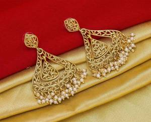 Here Is A Pretty Elegant Looking Heavy Designer Pair Of Earrings In Golden Color Beautified With Pearl Work. You Can Pair This Up With Any Colored Traditional Attire.