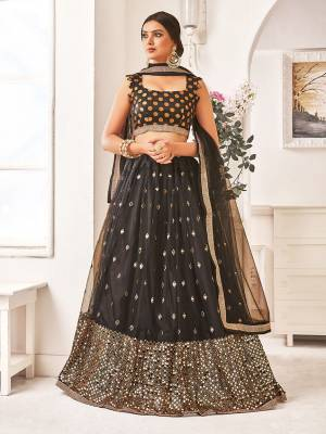Adorn A Bold And Beautiful Look In This All Over Black Colored Designer Lehenga Choli. Its Blouse Is Fabricated On Brocade Paired With Net Fabricated Lehenga And Dupatta.