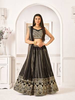 Adorn A Bold And Beautiful Look In This All Over Black Colored Designer Lehenga Choli. Its Blouse And Lehenga Are Fabricated On Satin Silk Paired With Net Fabricated Dupatta, Buy Now.