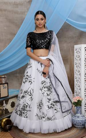 Grab This Beautiful Designer Lehenga Choli In Black And White Color. Its Heavy Sequence Embroidered Blouse Is Net Based Paired With Orgenza Fabricated Lehenga With Prints And Net Fabricated Dupatta.