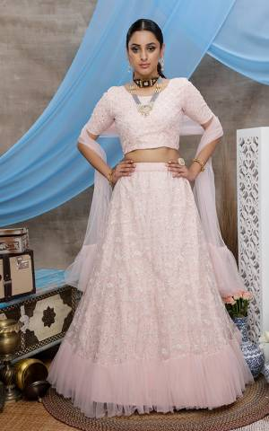 Look Pretty In This Lightest Shade Of Pink Colored Designer Lehenga Choli. This Pretty Piece Is Net Based Beautified With Elegant Tone To Tone Embroidery.