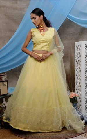Look Pretty In Light Yellow Colored Designer Lehenga Choli. This Pretty Piece Is Net Based Beautified With Elegant Tone To Tone Embroidery.