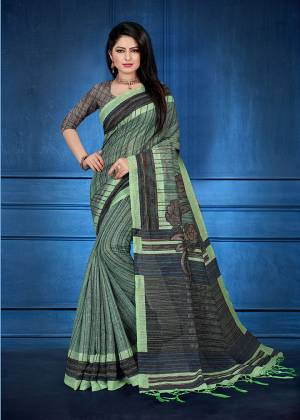 Add This Beautiful saree To Your Wardrobe In Green Color Fabricated On Handloom Silk. This Saree And Blouse Are Beautified With Prints And Easy To Carry All Day Long.