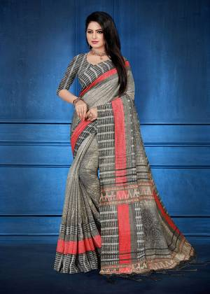 Add This Beautiful saree To Your Wardrobe In Grey Color Fabricated On Handloom Silk. This Saree And Blouse Are Beautified With Prints And Easy To Carry All Day Long.
