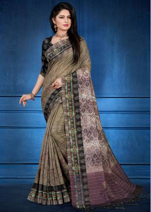 Add This Beautiful saree To Your Wardrobe In Brown Color Fabricated On Handloom Silk. This Saree And Blouse Are Beautified With Prints And Easy To Carry All Day Long.