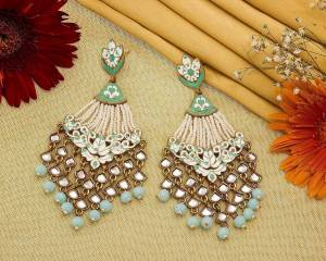 Grab This Pretty Heavy Earrings To Give An Enhanced Look To Your Ethnic Attire. It Is Beautified With Lovely Kundan And Pearl Work. Also It Is Light In Weight And Easy To Carry Throughout The Gala. Buy Now.