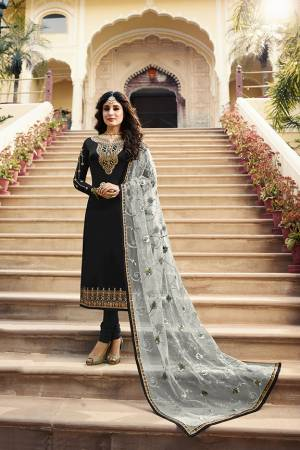 Grab This Very Beautiful Designer Straight Suit In Black Color Paired With Pretty Embroidered Grey Colored Dupatta. Its Top Is Fabricated On Satin Georgette Paired With Santoon Bottom and Net Fabricated Dupatta. Buy This Designer Embroidered Suit Now.