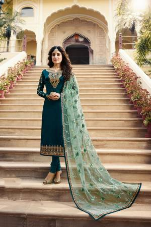Grab This Very Beautiful Designer Straight Suit In Teal Blue Color Paired With Pretty Embroidered Pastel Green Colored Dupatta. Its Top Is Fabricated On Satin Georgette Paired With Santoon Bottom and Net Fabricated Dupatta. Buy This Designer Embroidered Suit Now.
