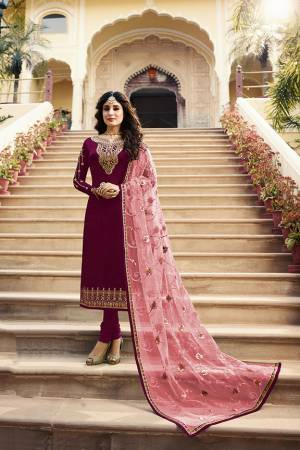 Grab This Very Beautiful Designer Straight Suit In Maroon Color Paired With Pretty Embroidered Peach Colored Dupatta. Its Top Is Fabricated On Satin Georgette Paired With Santoon Bottom and Net Fabricated Dupatta. Buy This Designer Embroidered Suit Now.