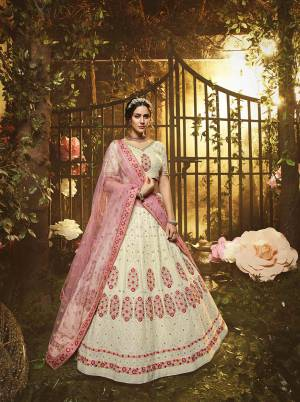 Grab This Very Beautiful Heavy Designer Lehenga Choli In Off-White color Paired With Baby Pink Colored Dupatta. This Pretty Heavy Embroidered Lehenga Choli Are Fabricated On Georgette Paired With Net Fabricated Dupatta. Buy This Pretty Piece Now.