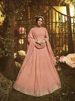 You Will Definitely Earn Lots Of Compliments Wearin This Pretty Looking Heavy Designer Lehenga Choli In Peach Color. This Lehenga, Choli And Dupatta Are Fabricated On Georgette Beautified With Tone To Tone Pretty Embroidery.