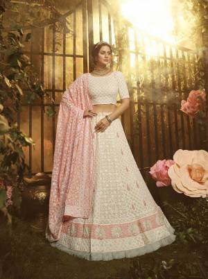 Grab This Very Beautiful Heavy Designer Lehenga Choli In Off-White color Paired With Peach Colored Dupatta. This Pretty Heavy Embroidered Lehenga, Choli And Dupatta Are Fabricated On Georgette. Buy This Pretty Piece Now.