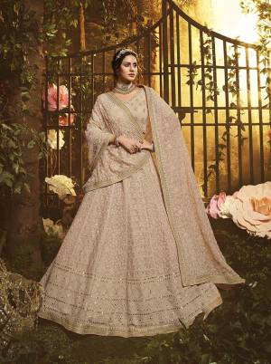 You Will Definitely Earn Lots Of Compliments Wearin This Pretty Looking Heavy Designer Lehenga Choli In Pastel Brown Color. This Lehenga, Choli And Dupatta Are Fabricated On Georgette Beautified With Tone To Tone Pretty Embroidery.