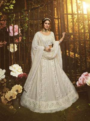 Look Like A Goddess Diva Wearing This Pretty Elegant Designer Lehenga Choli In Off-White Color. Its Blouse, Lehenga And Dupatta Are Georgette Based Beautified With Heavy Yet Subtle Looking Embroidery All Over.