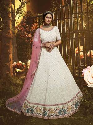 Grab This Very Beautiful Heavy Designer Lehenga Choli In White color Paired With Pink Colored Dupatta. This Pretty Heavy Embroidered Lehenga Choli Are Fabricated On Georgette Paired With Net Fabricated Dupatta. Buy This Pretty Piece Now.