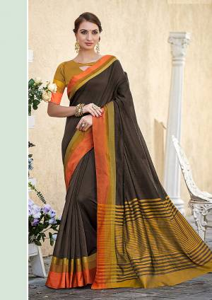 A Must Have Range Of Plain Saree To Your Wardrobe IS Here In Dark Brown Color Paired With Contasting Musturd Yellow Colored Blouse. This Saree And Blouse Are Fabricated On Cotton, It Is Light Weight And Easy To Carry.
