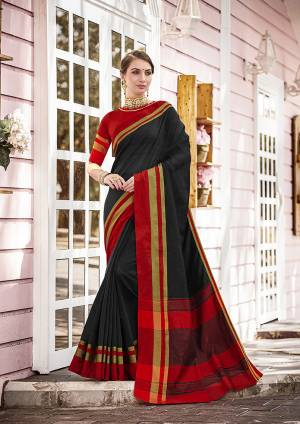 A Must Have Range Of Plain Saree To Your Wardrobe IS Here In Black Color Paired With Contasting Red Colored Blouse. This Saree And Blouse Are Fabricated On Cotton, It Is Light Weight And Easy To Carry.