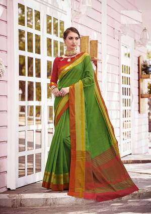 A Must Have Range Of Plain Saree To Your Wardrobe IS Here In Green Color Paired With Contasting Red Colored Blouse. This Saree And Blouse Are Fabricated On Cotton, It Is Light Weight And Easy To Carry.