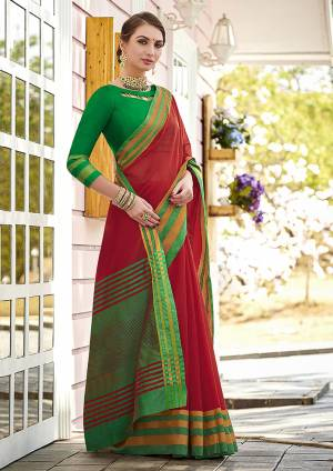 Grab This Pretty Simple And Elegant Looking Plain Saree In Red Color Paired With Green Colored Blouse. This Saree And Blouse Are Cotton Based Which Is Durable, Light Weight And Easy To Care For.