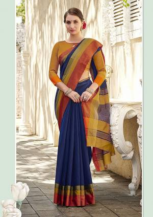 For Your Casual Or Semi-Casual Wear, Grab This Solid Pattern Saree In Navy Blue Color Paired With Contrasting Musturd Yellow Colored Blouse. This Saree and Blouse Are Fabricated On Cotton Which Is Suitable For Daily Wear. Buy This Pretty Simple Saree Now.