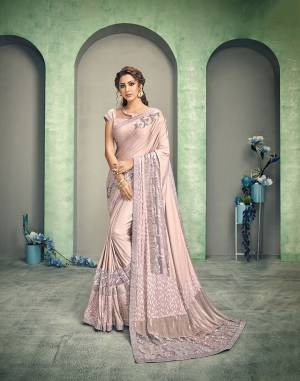 It's time for an updated style statement. Curated in a shade of Vintage Rose Pink, the combination of multiple fabrics - jacquard , sequins net and crush fabric, placed in unique style makes this saree super gorgeous.