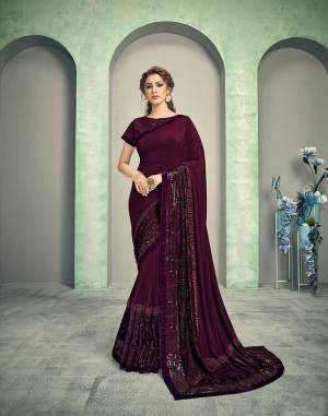 Perfect for your next cocktail party- this deep wine saree is an ultimate pick.  Keep the jewelry minimal to just one statement piece to look charming.