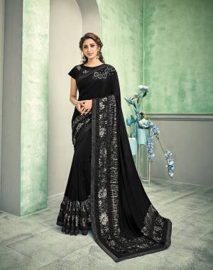Black is the color of tremendous beauty and power. This cocktail-edition saree with value addition foiled sequins is a sight to behold. It's time to give yourself a touch of silver and shimmy.