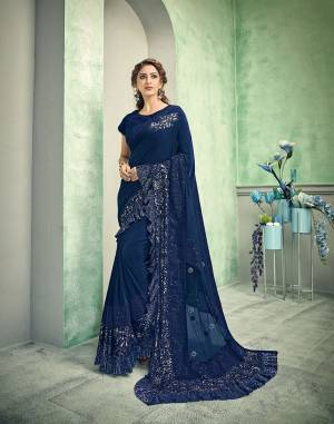 Queenly and powerful - this royal blue saree is a symbol of designer tastes. With meticulous placements of multiple fabrics and touch of handwork details - this saree is a pick for fashion-loving souls.