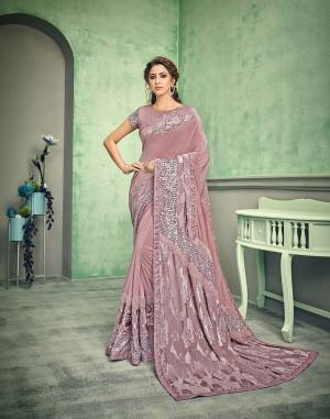 A gentle play of various textures and unique cuts and patterns makes this saree a piece of desire. Drape it in a free-falling pallu style to make the most of the designer short pallu.