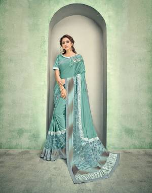 Look as serene and as beautiful as the ocean in this sea-green saree adorned with beautiful sequins embroidery and hand work butta.