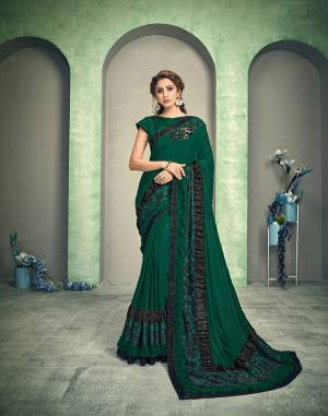 Green is the color of harmony and superb style. Designed to perfection and gently combined with green and black jacquard - this saree is in sync with trend-du-jour.